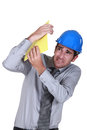 Engineer shielding himself from a blow Royalty Free Stock Image
