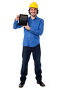 Engineer showing his new touch pad device handsome architect brand tablet Stock Photos