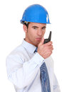 Engineer speaking into his walkie-talkie Royalty Free Stock Images