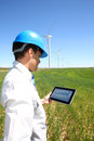 Engineer with tablet in wind turbine field businessman checking on energy production Stock Photography