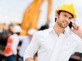 Engineer talking on the phone a construction site Royalty Free Stock Photography