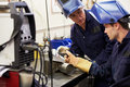 Engineer Teaching Apprentice To Use TIG Welding Machine Royalty Free Stock Photo
