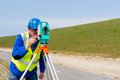 Engineer and total station or theodolite working with a modern on a tripod Stock Images