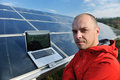 Engineer using laptop at solar panels plant field Royalty Free Stock Image