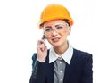 Engineer woman over white background happy with protective helmet on phone isolated on close up of female contractor or Royalty Free Stock Images