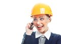 Engineer woman over white background smiling with protective helmet on phone isolated on close up of female contractor or Royalty Free Stock Image