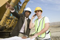 Engineer With Worker At Construction Site Royalty Free Stock Images