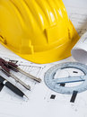Engineer workplace with blueprints compass pen protractor and safety helmet Stock Photo