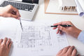 Engineering or Creative architect in construction project, Engineers hands working with compasses on construction blueprint build