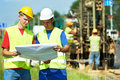 Engineers builders at road works construction site Royalty Free Stock Photos