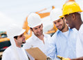 Engineers at a construction site group of talking Royalty Free Stock Photography
