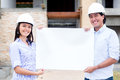 Engineers holding a banner Royalty Free Stock Image