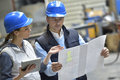 Engineers in industrial factory reading instructions Royalty Free Stock Photo