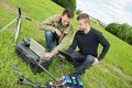 Engineers repairing uav helicopter young male discussing over digital tablet and laptop by drone in park Stock Photography