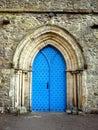 England: Cartmel Priory church blue door