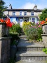 England: hillside house with garden in Kendal Stock Photography