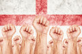 England labour movement workers union strike concept with male fists raised in the air fighting for their rights english national Stock Photography