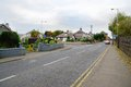England suburb typical with crossroads and speeding car Royalty Free Stock Photo