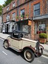 England: vintage car and old shops Royalty Free Stock Image