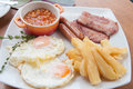 English breakfast with bacon eggs potatoes and beans Royalty Free Stock Image