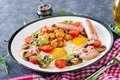 English breakfast - fried egg, beans, tomatoes, mushrooms, bacon and sausage. Royalty Free Stock Photo
