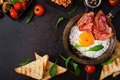 English breakfast - fried egg, beans, tomatoes, mushrooms, bacon and toast. Royalty Free Stock Photo