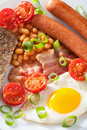 English breakfast with fried egg sausages bacon tomatoes beans tomato Royalty Free Stock Photography