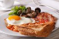English breakfast: fried eggs with bacon and vegetables Royalty Free Stock Photo