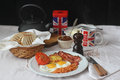 English breakfast with sunnyside eggs beans hashbrown roasted tomato orange jam butter toast and tea Royalty Free Stock Images