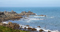 English channel from lihou island off the of guernsey Stock Photography