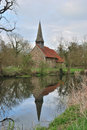 English church by canal Stock Photo