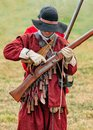 English Civil War Militiaman priming his musket. Royalty Free Stock Photo