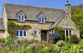 English Cotswolds cottage with flowering summer garden Royalty Free Stock Photo