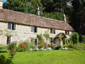 English cottage with flower garden Royalty Free Stock Photo
