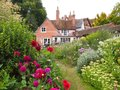 English Cottage Garden in Warwickshire Royalty Free Stock Photo