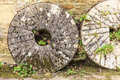 English cottage and old stone wheels Royalty Free Stock Photo