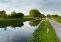 English country scene with canal and lock gates on a calm still day Royalty Free Stock Images