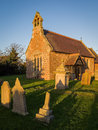 English country village church old in an in late afternoon or evening light shropshire england Stock Photos