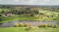 English countryside, grand house and river; aerial view. Royalty Free Stock Photo