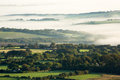 English countryside low lying mist over the Royalty Free Stock Image