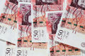 English fifty pound notes scattered sterling england uk western europe Royalty Free Stock Photo
