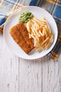English food: fried fish in batter with chips. vertical top view Royalty Free Stock Photo