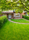 English front garden lawn of a brick house in england Stock Photo
