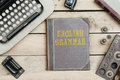 English Grammar on old book cover at office desk with vintage it Royalty Free Stock Photo