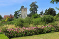 An english landscaped garden walled with rose beds and church Royalty Free Stock Photos