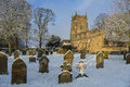 English parish church north yorkshire england winter snow in the graveyard of an in the small village of slingsby in in northern Royalty Free Stock Photos