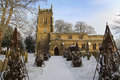 English parish church north yorkshire england winter snow in the graveyard of an in the small village of slingsby in in northern Stock Images