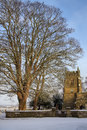 English parish church north yorkshire england winter snow and an in the small village of slingsby in in northern Royalty Free Stock Images