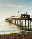 English pier by the sea tradititonal structure and beach a traditional in england Royalty Free Stock Images