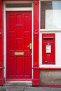English Red Letter  Box next to a red door Royalty Free Stock Photos